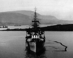 80-G-81452: Royal Navy cruiser, HMS London, in Scapa Flow, Orkney Islands, Scotland, August , 1943. U.S. Navy Photograph, now in the collections of the National Archives.
