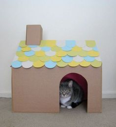 DIY Cat house - Just a regular cardboard box! Spray paint the inside and adjust the flaps to make the roof. Leave the sides of the roof open so then can jump in and out for even more fun! Chimney out of leftover cardboard and make shingles with scrap paper!
