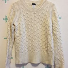 J.Crew White Cream Cable Knit Sweater This cozy, thick sweater is a white cream color, and is a size small. It's in great condition, and only has one small mark on it, shown in the third picture. The mark is on the front of the sweater around the bust. It's barely noticeable, and I honestly had to look for a while to find the stain to take a picture of it. Make me an offer! J. Crew Sweaters Crew & Scoop Necks