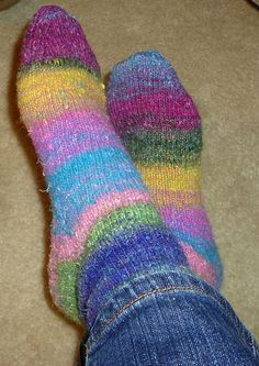 "the second pair of sock i ever knit. i used the pattern ""how i knit my socks"" using noro sock yarn"