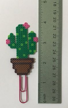 This Cactus Planner clip is a fun way to add a little happiness to any schedule or to do list! Check out Happy Hearts Paper Co. on Etsy and Instagram for more fun planner ideas and Perler bead planner accessories and bookmarks. #plannerideas #plannercharm #planners #plannergoodies #planneraccessories #keychain #perlerbeads #deskdecor #officedecor