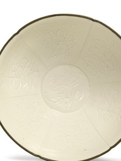 An extremely fine and rare carved 'Ding' 'Peony' bowl, Northern Song dynasty