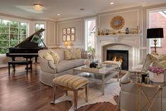 Traditional Living Room with Foxy Metallic Finish Stool Custom Upholstered, Chair rail, stone fireplace, Henredon Jensen Sofa