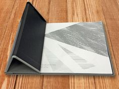 (Image 2 of 3): Interscrew binder, which can be opened by the customer any time to add/remove sheets. The customer wanted the cover to fold several times to create a look and feel similar to an iPad case. Bookbinding by www.document-centre.co.uk, South London.