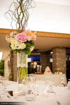 Tall vases with a lace wrap and branches for romance and height!