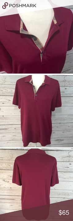 Burberry Brit plaid placket  Burgundy polo shirt Burberry Brit plaid placket burgundy polo shirt in soft cotton jersey. Lighter weight & softer than Burberry pique knit polo. The Burberry logo is on the bottom left of shirt instead of the chest. Made for Burberry in Peru. Last pic is from an article about high quality clothing made at the factory. Excellent pre-loved condition. No flaws. Material is 100% fine Peruvian cotton. All measurements taken with item laying flat and are approximate…