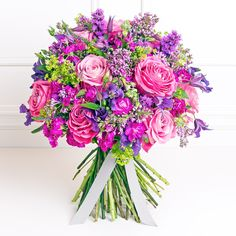Clematis, roses, liatris, stocks. Fuchsia, purple, lime. Pink & Lilac Rose Bouquets | Flowerona