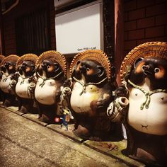 "Often statues of raccoon dogs can be seen in front of restaurants in Japan. ""Tanuki"" name of a raccoon dog in Japanese means ""overtake others"" so owners put clownish ""Tanuki"" for good luck. The statues made of chinaware called Shigaraki which has been developed in Shiga prefecture western Japan.  https://trulyjapan.net #TrulyJapan #raccoon #shigaraki #shiga #japan"