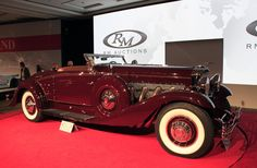This 1935 Duesenberg SJ convertible coupe by Walker-LaGrande sold for 4.5 million dollars at the RM Auction at the Amelia Island Concours d'Elegance.