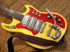 It's a Maton Fyrbyrd. Apparently Australian from the 60s. Wow!