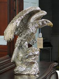 In the current market his larger birds like this eagle with a silver overlay sell at auction for over $600.00, with a replacment value for insurance purposes of about $1,100.00. http://blog.valuethisnow.com/posts/silver-eagle-sculpture#sthash.rDyneUOc.dpuf