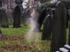 LITTLE GIRL GHOST! Looks like a little girl next to a grave.
