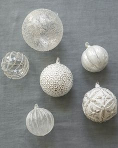 White and silver snow ornaments from the Red, White and Sparkle collection.