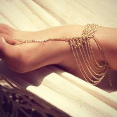 NWOT Golden layered anklet with toe attachment One piece!!! Golden tone adjustable layered anklet with toe ring attachment. Super cute! I am not a gold wearer but I ADORE these. Pics don't do it justice. Feels neat on the skin too. Jewelry