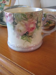 1 of 6 cups painted by Wilma Leighton, she also painted a small punch bowl to complete the set. It is a lovely set!