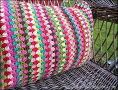 crochet pillow - page is in Norwegian, but the pattern is just 3dc, ch1. I wonder if I have enough colors to try this?