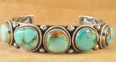 Handmade row cuff bracelet, with natural rare Easter Blue Turquoise, by Navajo artist Ned Nez.