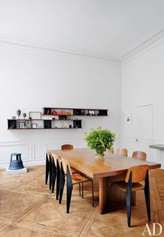 Dining room: Parquetry floors, white walls, great shelving and lots of light.