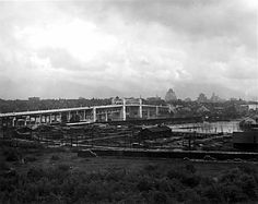 Burrard Bridge and False Creek with Kitsilano Trestle VPL Accession Number: Date: 1932 Photographer / Studio: Frank, Leonard Content: View looking North East Part of a series 6583 - The Search, Historical Images, Photographic Studio, Vancouver, Paris Skyline, Bridge, Content, Number, History