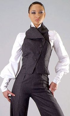 White Victorian dress shirt with baloon sleeves, grey pinstriped pantsuit consisting of vest with asymmetrical placket