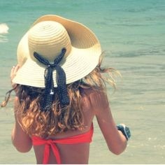 Floppy hat and neon bathing suit. If only I could pull off neon. Or hats.
