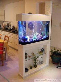 Splendid DIY Aquarium Furniture Ideas To beautify Your Home – CueThat diy aquarium furniture stands are an integral part of every aquatic system. The aquarium stand should be sturdy so that it can bear the weight of a filled a. Diy Aquarium, Wall Aquarium, Aquarium Setup, Aquarium Design, Aquarium Stand, Aquarium Ideas, Living Room Partition Design, Room Partition Designs, Partition Ideas