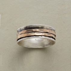 RONDELLE RING -- Two rings hand hammered of 14kt gold fill, make the rounds within our exclusive sterling silver ring. Brushed finish. Handmade in USA. Whole sizes 5 to 9.