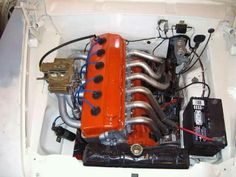 Slant six Chrysler experiment.  This was on the Slant Six Forum and I believe was late model (Gen III) Hemi cylinder heads cut and merged together with a couple Gen I Hemi valve covers spliced together and custom intake/exhaust.  I believe I only made it to mock up stage and don't know if it was ever a running project?