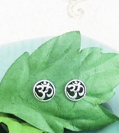 Free Shipping Both Ways! Bring more peace and harmony into your life with these simple 'om' earrings. Gently rounded and set within a solid, circular rim, these earrings evoke a sense o