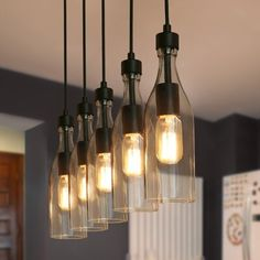 Longshore Tides Abandon complicated lamp design, only use 5 glass bottles in the kitchen making pendant can be the best choice for your kitchen island. Whether it is Modern Farmhouse, Urban Rustic, Industrial or Mid-century, this 5-Light Linear Pendant can meet your needs for style. You need to purchase 5 E26 dimming bulbs and dimmer switches(both not include)to meet the lighting needs. In addition, the height of the suspension chain can be adjusted to fit any space you have. | Longshore… Urban Rustic, Rustic Industrial, Ceiling Lamp, Ceiling Lights, Wood Canopy, Bottle Chandelier, Kitchen Island Lighting, Island Pendants, Mason Jar Lamp