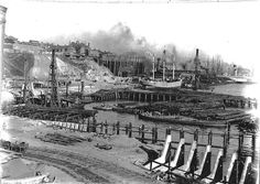 East Darling Harbour in Sydney.The gas tank from AGL Gasworks is in the top middle of photo.Wharves are bei g constructed and ships are being unloaded.Photo from City of Sydney Archives.A♥W