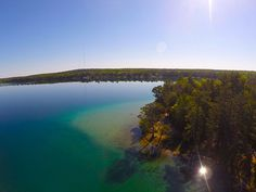 Aerial image of Clear Lake, Clear Lake State Park, MI. I want to go there. Michigan State Parks, Aerial Images, Clear Lake, Get Outside, Campsite, Outdoor Activities, The Great Outdoors, Acre, Camping
