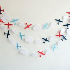 The ever popular airplane garland is back! Hooray! The perfect garland for a little boys birthday party or bedroom! This one would be super cute for a photo shoot as well.  This listing is for:  ONE 15 FT long (4.5 Metres) Circle Paper Garland *The airplanes measure 3 wide by 2 tall *Made from 65lb card stock + premium quality thread *Colours Included: Navy, Red, White & Sky Do you love the look of this garland but need custom colours for your party or photo shoot? I am more than happy to…