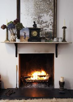 To keep the elegant period theme going, the mantle top in this fireplace-focussed living room is fixed onto decorative cast-iron wall brackets, creating a unique fire surround effect. Living Room Update, Living Room Modern, Living Spaces, Home Fireplace, Living Room With Fireplace, Fireplaces, Decorative Room Dividers, Vintage Room, Living Room Pictures