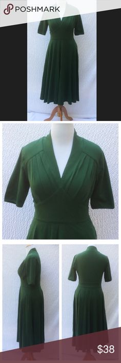 """New Eshakti Fit & Flare Knit Midi Dress L 12 New Eshakti green fit & flare midi dress L 12 Measured flat: underarm to underarm: 36"""" Waist: 32"""" Length: 47 1/2"""" Sleeve: 11 1/2"""" Eshakti size guide for 12 bust: 38 1/2"""" High back neck, low front V, hidden side zipper, pleated bodice. Wide banded empire waist, flared skirt w/side seam pockets. Cotton/spandex, jersey knit, light structured feel, light stretch, lighter midweight. Machine wash. New w/ cut out Eshakti tag eshakti Dresses Midi"""