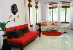 The modern and spacious living room of Casa Verde. There is a bed sofa which provides space for two more people and a well euipped kitchen in the house too.