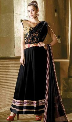 With florence, glam-chic looks are never hard to do as you don this black color georgette long Anarkali churidar suit. The wonderful lace, patch and resham work a intensive attribute of this attire. #designeranarkalisuit #anarkalisuit #anarkalidresscollection