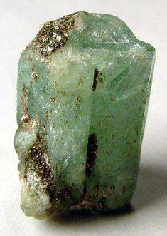 Uncut emerald crystal, a green gemstone beryl. - Ryan Salsbury