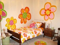 flowers painted on walls | these flowers were inspired by the bedding on her little