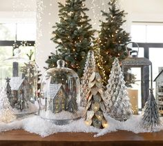 Cute idea to put the holiday villiage houses under a cloche . Aff