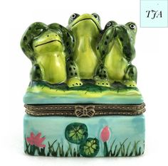 Frog See No Evil, Hear No Evil, Speak No Evil Jewelry Box can be used for Secret Messages, Love Notes, Jewelry, storing precious Baby Keepsakes and other valuables.   - Made in China  - 3 Frogs on a lily pad jewelry box.  - Green and Blue Coloring with pink flowers  - Hinged  - Stands 3 1/4 inches tall 2 1/2 wide.