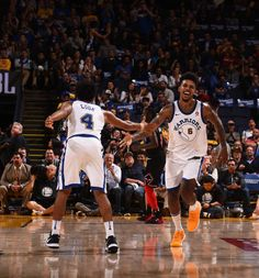 Nick Young and Quinn Cook of the Golden State Warriors high five during the game against the Chicago Bulls on November 24 2017 at ORACLE Arena in...