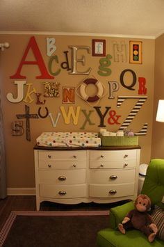 For a baby shower, each guest is assigned a letter of the alphabet.  They bring their letter, and the mismatched alphabet gets to hang on the nursery wall.  So adorable!