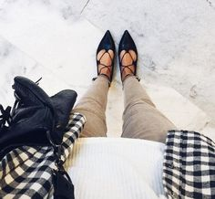 A flannel shirt with a tee, suede leggings, ballet flats, and a trusty crossbody bag.