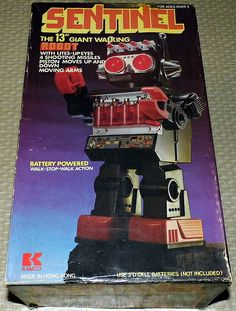 Vintage Sentinel 13 Inch Giant Walking Robot By Kamco, With Lite-Up Eyes And 4 Shooting Missles, Battery Powered, Item No. 8833, Made in Hong Kong.