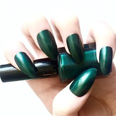 Dark Green with Black and Turquoise Undertones ($4.99) ❤ liked on Polyvore featuring beauty products, nail care, nail polish and shiny nail polish
