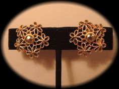 Signed Coro Gold Tone Cut Out Flower Scewback by thejeweledbear, $12.00