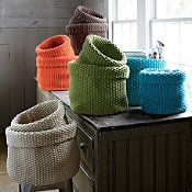 Knitted Basket Set. I'm going to try knitting with rope and see if I can get something close to this.