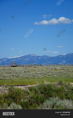 Mountains provide a scenic background for grazing land and corrals near Dillon, Montana. ©Photo copyright by Marty Nelson. Photographer website:  http://www.bigstockphoto.com/image-137042720/stock-photo-mountains-provide-a-beautiful-background-for-corrals-and-sagebrush-grazing-land-near-dillon%2C-montana
