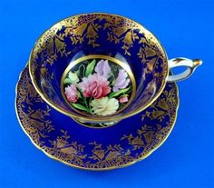 Gorgeous Sweet Pea Center with a Gold and Cobalt Paragon Tea Cup and Saucer Set